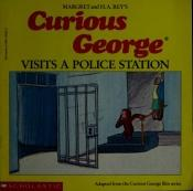book cover of Curious George visits a police station by H.A. and Margret Rey